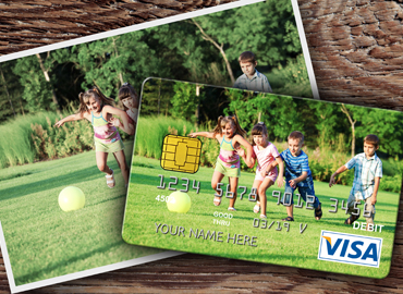A photo of children playing ball in the yard turned into your debit card with WSB's Debit by Design.